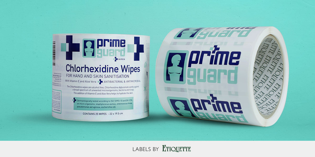 Self-adhesive, custom printed Sanitising hand wipes labels on a roll for machine application.